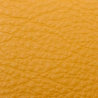 Материал кожа желтого цвета